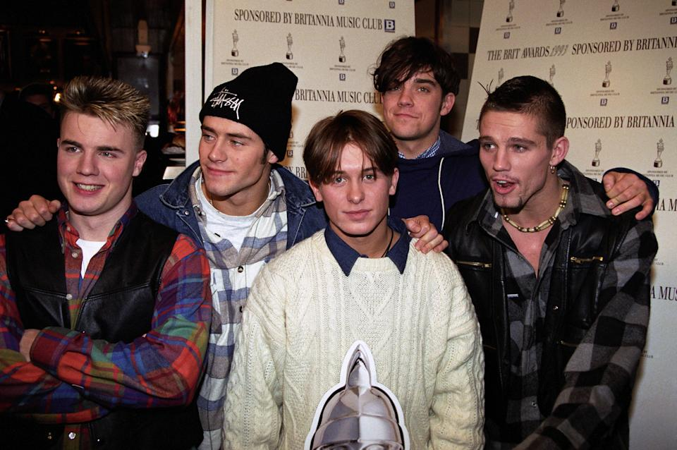 Take That, who are among the nominees for the Best British Newcomers award at the Music Industry Oscars, at the Hard Rock Cafe in London. (L - R) Gary Barlow, Howard Donald, Mark Owen, Robbie Williams and Jason Orange.   (Photo by Neil Munns - PA Images/PA Images via Getty Images)