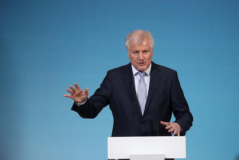 Horst Seehofer, leader of the Christian Social Union (CSU) party, gestures as he speaks during a news conference following overnight coalition negotiations, at the Social Democratic Party headquarters in Berlin, Germany, on Friday, Jan. 12, 2018. After a marathon of more than 24 hours of talks to end Germany's political gridlock, leaders of Merkel's Christian Democratic Union, her Bavarian sister party and the Social Democrats hammered out a 28-page agreement. Photographer: Krisztian Bocsi/Bloomberg