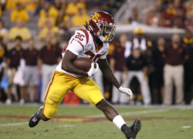"<a class=""link rapid-noclick-resp"" href=""/ncaaf/players/274317/"" data-ylk=""slk:Ronald Jones"">Ronald Jones</a> ran for three touchdowns vs. Arizona. (AP Photo/Ralph Freso)"