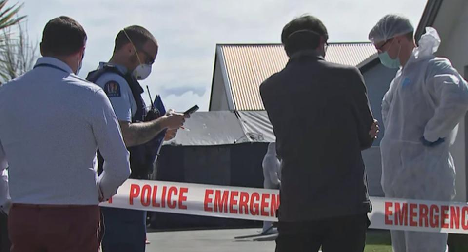 Police are pictured at the home in Timaru, New Zealand, where three girls were found dead.