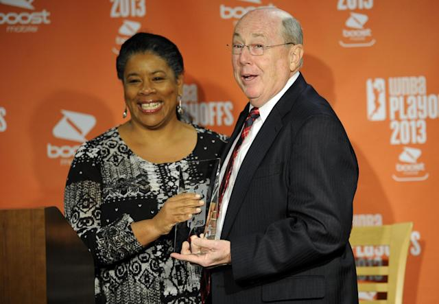Washington Mystics head coach Mike Thibault, right, reacts after he was presented the WNBA Coach of the Year award from WNBA president Laurel J. Richie, left, during a press conference before Game 2 of their WNBA basketball Eastern Conference semifinal series against the Atlanta Dream, Saturday, Sept. 21, 2013, in Washington. (AP Photo/Nick Wass)