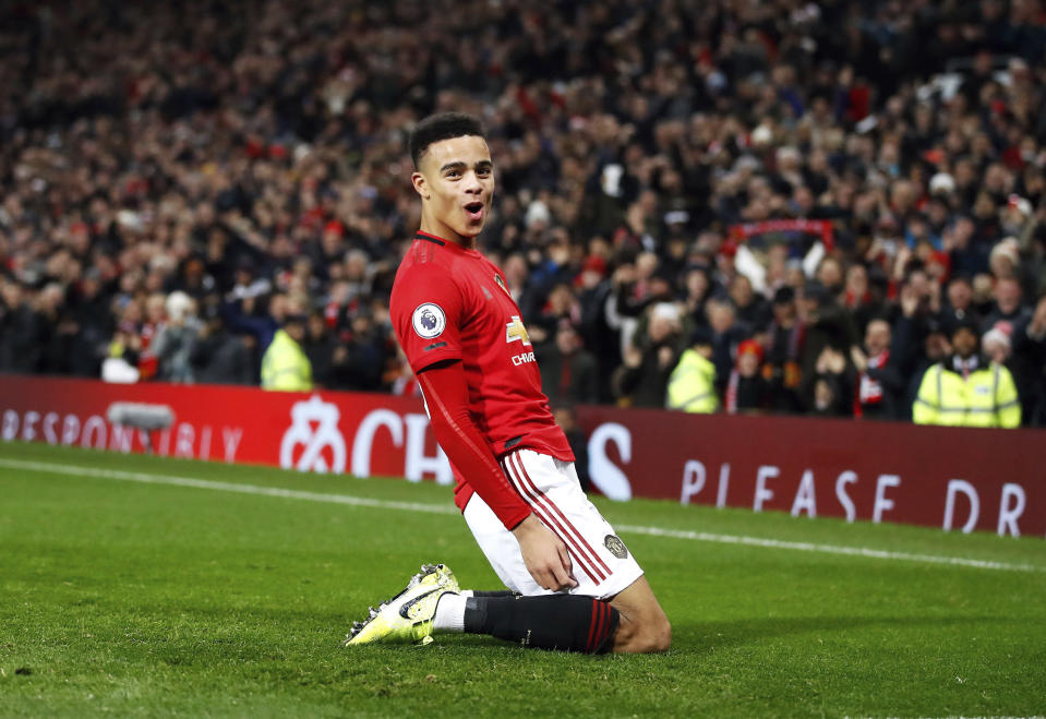 Manchester United's Mason Greenwood celebrates scoring his side's second goal of the game during their English Premier League soccer match against Newcastle United at Old Trafford, Manchester, England, Thursday, Dec. 26, 2019. (Martin Rickett/PA via AP)