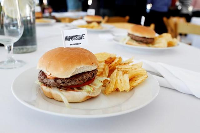 The completed plant-based hamburger is displayed during a media tour of Impossible Foods labs and processing plant in Redwood City, California