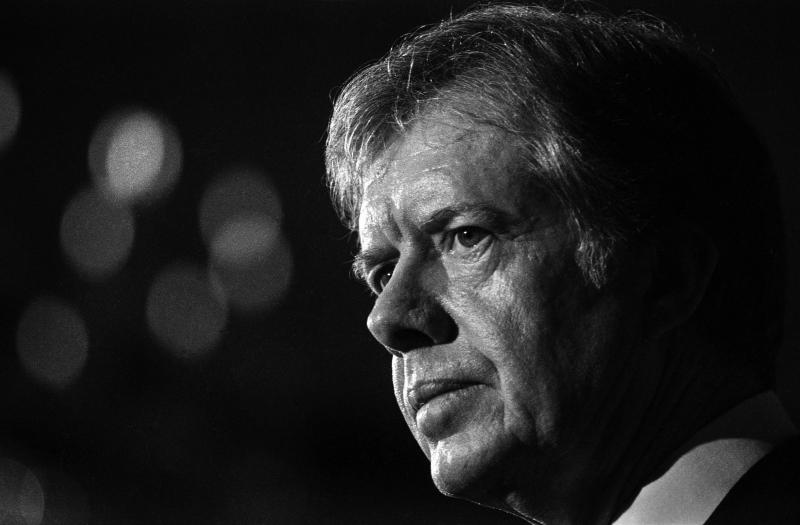 Profile of American politician US President Jimmy Carter as he speaks during an unspecified event, Washington DC, January 20, 1980. As part of the speech, he discussed the then-ongoing international incident involving the Soviet invasion of Afghanistan, suggesting a US-led boycott of the scheduled Moscow Summer Olympic Games if the Soviet Union failed to withdraw its troops; along with other countries, the US did later official boycott the games. (Photo by Leif Skoogfors/Getty Images)