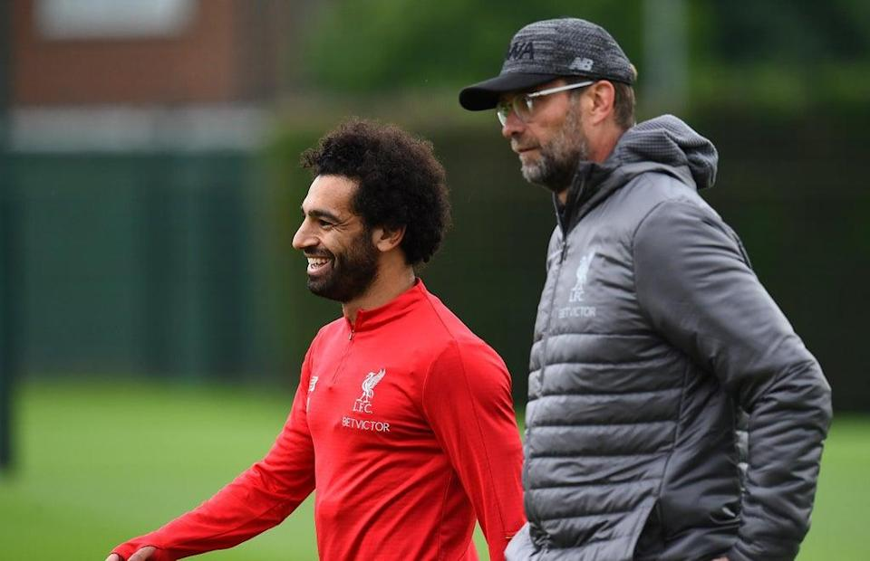 Jurgen Klopp (right) is staying out of Mohamed Salah's contract discussions  (Liverpool FC via Getty Images)