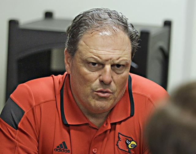 Louisville defensive coordinator Todd Grantham discusses his observations from the first week of practice for the Cardinals' NCAA college football team during media day in Louisville, Ky., Saturday, Aug. 9, 2014. (AP Photo/Garry Jones)