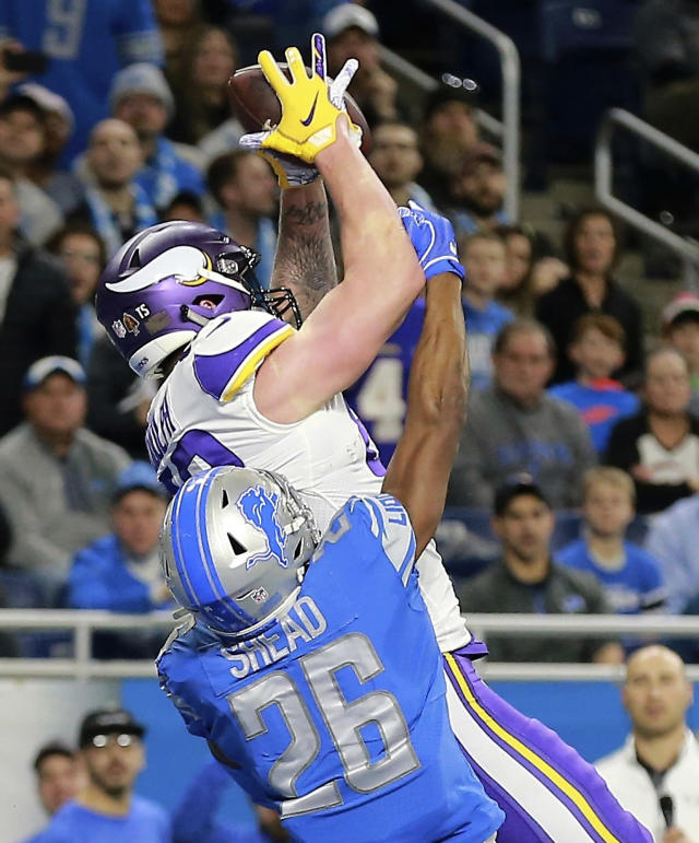 Minnesota Vikings tight end Kyle Rudolph, defended by Detroit Lions defensive back DeShawn Shead (26), catches a 44-yard pass for a touchdown with no time on the clock during the first half of an NFL football game, Sunday, Dec. 23, 2018, in Detroit. (AP Photo/Rey Del Rio)