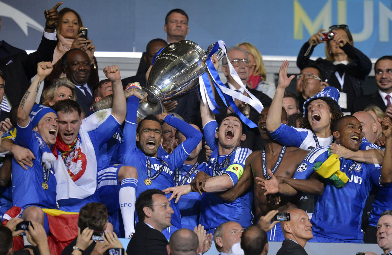 Chelsea's Jose Bosingwa holds up the trophy at the end of the Champions League final soccer match between Bayern Munich and Chelsea in Munich, Germany Saturday May 19, 2012. Didier Drogba scored the decisive penalty in the shootout as Chelsea beat Bayern Munich to win the Champions League final after a dramatic 1-1 draw on Saturday. (AP Photo/Martin Meissner)