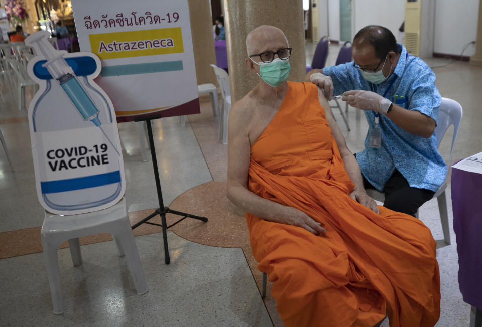 A health worker administers a dose of the AstraZeneca COVID-19 vaccine to a Buddhist monk at Nak Prok Temple in Bangkok, Thailand, Friday, April 9, 2021. (AP Photo/Sakchai Lalit)