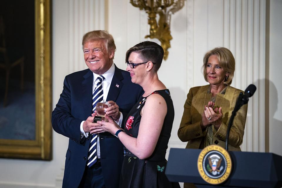 In 2018, President Donald Trump gave the National Teacher of the Year award to Washington educator Mandy Manning. She accepted wearing pins for transgender and LGBTQ rights. (Photo: Getty Images)