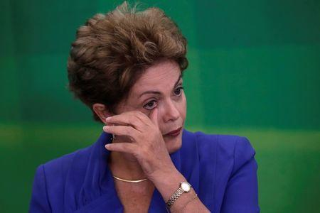 Brazil's President Dilma Rousseff reacts during a launching ceremony for the Anti-Corruption Package at the Planalto Palace in Brasilia