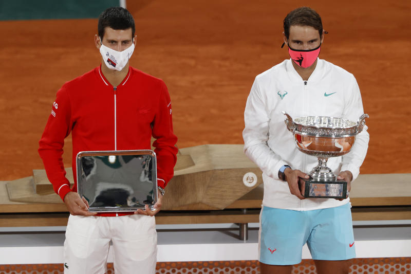 PARIS, FRANCE - OCTOBER 11: Runner-up Novak Djokovic of Serbia (L) and winner Rafael Nadal of Spain pose with their respective trophies following their Men's Singles Final on day fifteen of the 2020 French Open at Roland Garros on October 11, 2020 in Paris, France. (Photo by Clive Brunskill/Getty Images)