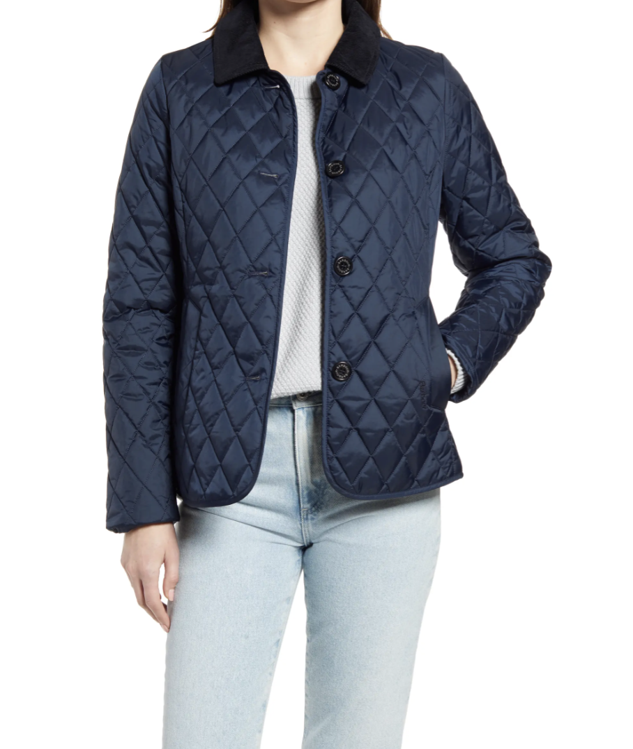 model wearing navy Barbour Sterndale Quilted Jacket a white t-shirt and light wash jeans