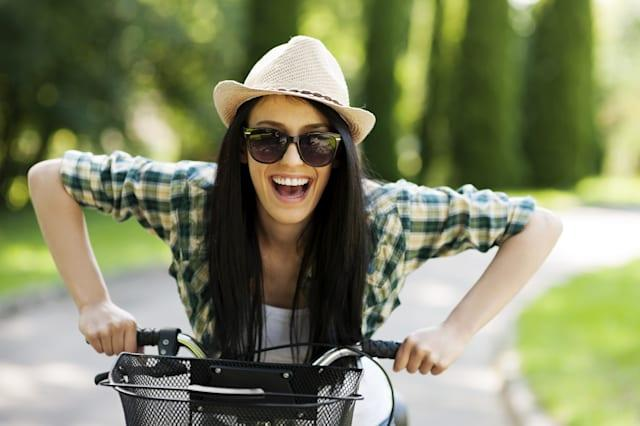 happy young woman with bicycle
