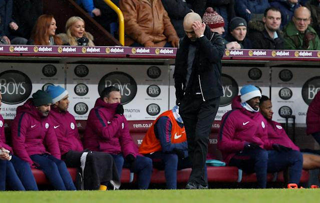 "Soccer Football - Premier League - Burnley vs Manchester City - Turf Moor, Burnley, Britain - February 3, 2018 Manchester City manager Pep Guardiola looks on REUTERS/Andrew Yates EDITORIAL USE ONLY. No use with unauthorized audio, video, data, fixture lists, club/league logos or ""live"" services. Online in-match use limited to 75 images, no video emulation. No use in betting, games or single club/league/player publications. Please contact your account representative for further details."