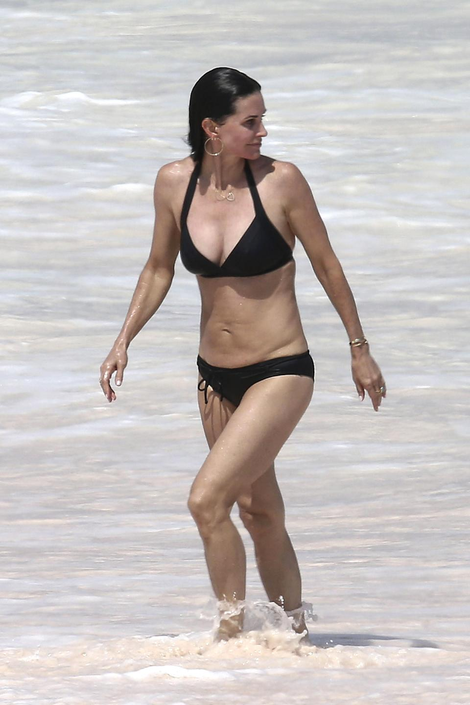 <p>Courteney Cox, 54, rocks a black bikini while in the Bahamas. (Photo: BackGrid) </p>