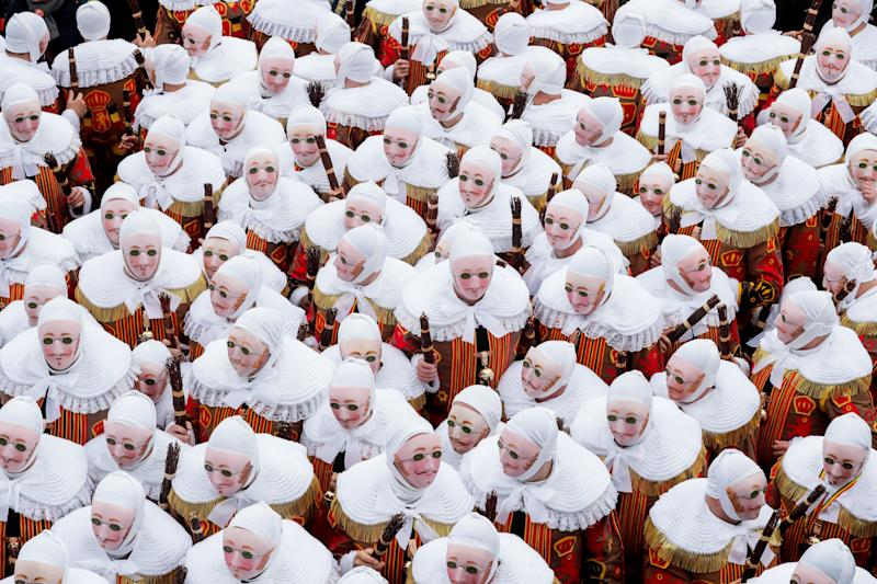 Festival participants known as 'Gilles', wearing traditional costumes, during Carnival celebrations in the streets of Binche, Belgium, March 5, 2019. (Photo: Stephanie Lecocq/EPA-EFE/REX/Shutterstock)