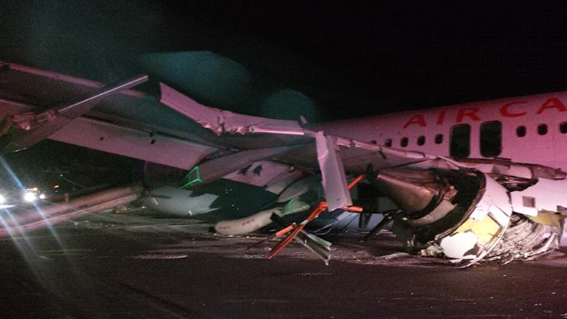 Handout photo by the Canada Transportation Safety Board shows wing damage to an Air Canada Airbus A-320 that skidded off the runway at Halifax International Airport in Halifax, Nova Scotia, March 29, 2015 (AFP Photo/)