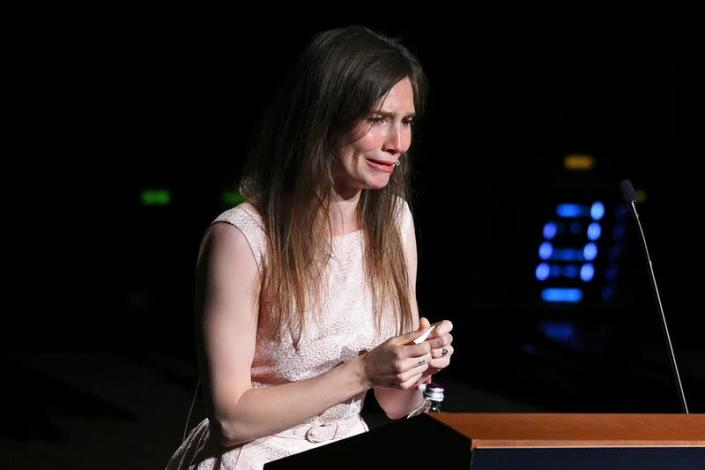 FILE PHOTO: Amanda Knox, who has returned to Italy for the first time since being cleared of the murder of British student Meredith Kercher, cries as she speaks at the Criminal Justice Festival in Modena