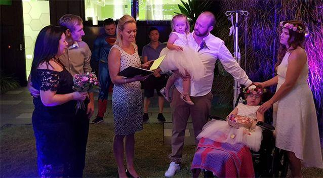 Jacob and Tania Skarratts exchange their wedding vows in front of flower girl Paige and 30 guests.