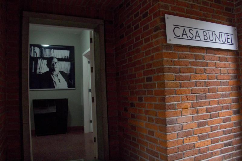 """In this Aug. 1, 2013 photo, a photograph of Spanish filmmaker Luis Bunuel hangs at the entrance of """"Casa Bunuel"""" in Mexico City. The Spanish government has opened this house after restoring the facade and conditioning the interiors. Now, the Spanish government, which bought the house from Bunuel's family, has opened the house to a public long fascinated with his work. (AP Photo/Gabriela Sanchez)"""