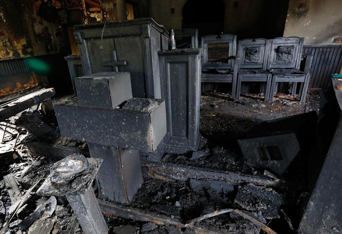 <p>Burned pews, destroyed musical instruments, Bibles and hymnals are part of the debris inside the fire damaged Hopewell M.B. Baptist Church in Greenville, Miss., Wednesday, Nov. 2, 2016. (AP Photo/Rogelio V. Solis) </p>