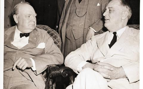Churchill and President Franklin D. Roosevelt pictured during the meeting of the Pacific War Council at the White House in June 1942 - Credit: Corbis