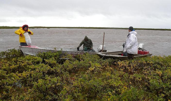 In this photo provided by the Department of Homeland Security and Emergency Management, Inupiat eskimos prepare to draw water from the Wulik River Tuesday, Aug. 28, 2012, in Kivalina, Alaska. Residents of a small Inupiat Eskimo village whose water supply pipeline was damaged by late summer storms are monitoring every drop of precious water they use, but officials there fear that might not be enough to last them through winter. That Kivalina even has water at all is a testament to efforts involving multiple partners including a Minnesota church that raised $1,100 for fuel to help villagers go out in boats and collect fresh water. (AP Photo, Carl Edwards/Department of Homeland Security and Emergency Management)