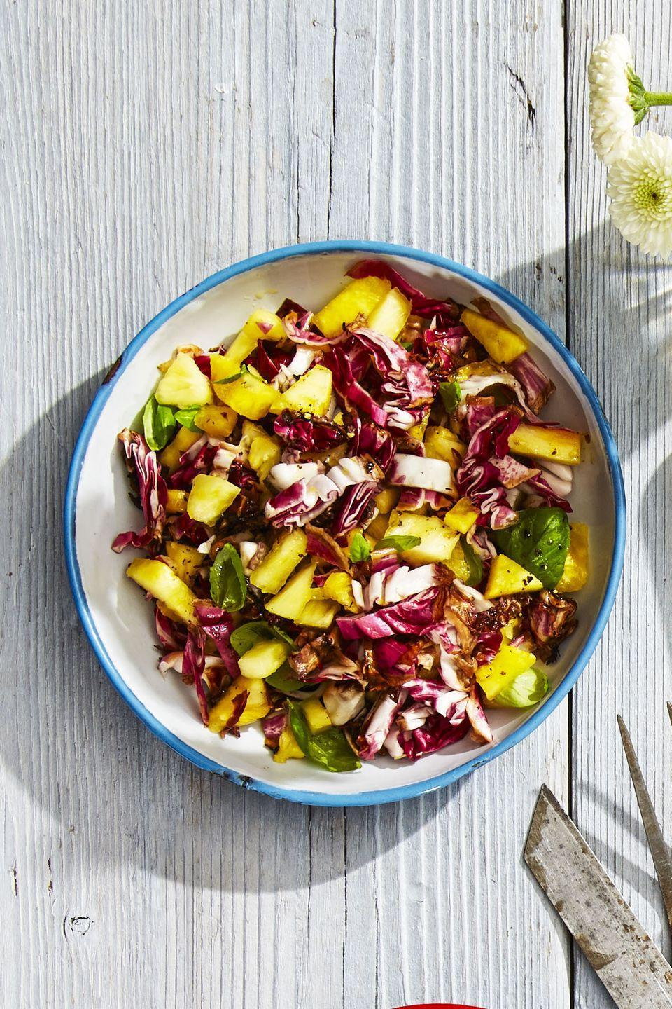 """<p>You'll want to put pineapple in all of your slaws after trying this bitter and sweet salad combo.</p><p><em><a href=""""https://www.goodhousekeeping.com/food-recipes/a39276/tropical-radicchio-slaw-recipe/"""" rel=""""nofollow noopener"""" target=""""_blank"""" data-ylk=""""slk:Get the recipe for Tropical Radicchio Slaw »"""" class=""""link rapid-noclick-resp"""">Get the recipe for Tropical Radicchio Slaw »</a></em></p>"""