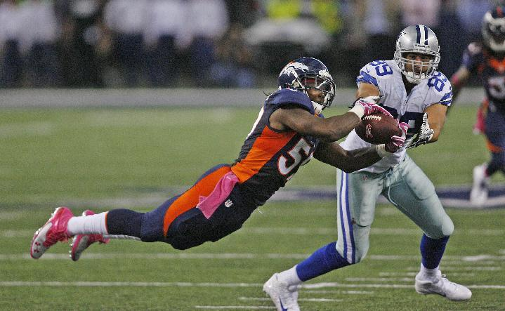 Denver Broncos outside linebacker Danny Trevathan (59) intercepts a pass from Dallas Cowboys quarterback Tony Romo, in front of Gavin Escobar (89) during the fourth quarter of an NFL football game Sunday, Oct. 6,2013, in Arlington, Texas. Denver won 51-48. (AP Photo/Dallas Cowbys, Sam Smith)