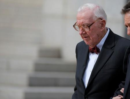 FILE PHOTO: Retired U.S. Supreme Court Justice John Paul Stevens departs the funeral of U.S. Supreme Court Associate Justice Antonin Scalia at the Basilica of the National Shrine of the Immaculate Conception in Washington