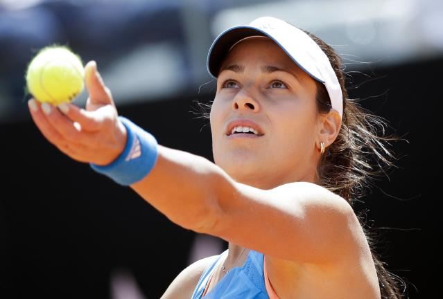 Ivanovic of Serbia serves to Sharapova of Russia during their women's singles match at the Rome Masters tennis tournament