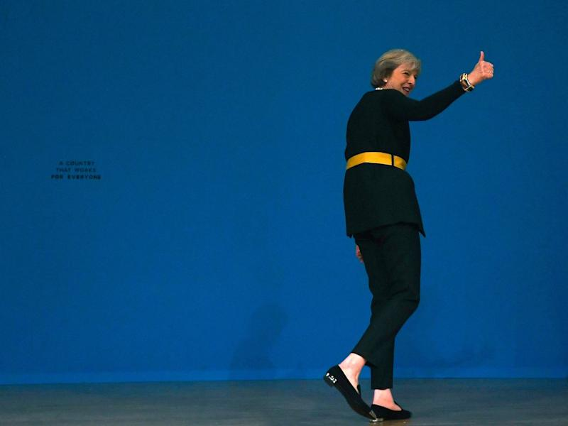 Britain's Prime Minister Theresa May's walks off stage after speaking at the annual Conservative Party Conference in Birmingham, Britain, October 2, 2016.