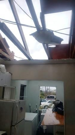 A damaged roof is seen at the house of a survivor following the aftermath of Hurricane Dorian in Marsh Harbour