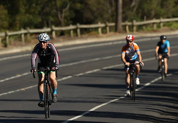 Cyclists are seen along the Boulevard in Melbourne's suburb of Kew.
