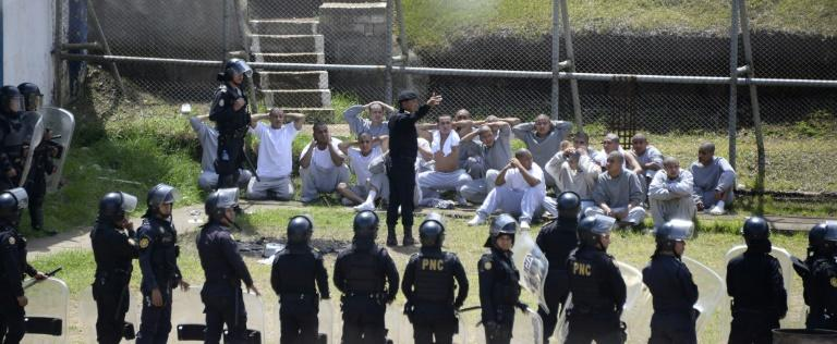 Riot police control inmates at a juvenile detention center in San Jose Pinula, east of Guatemala City, following a deadly prison riot