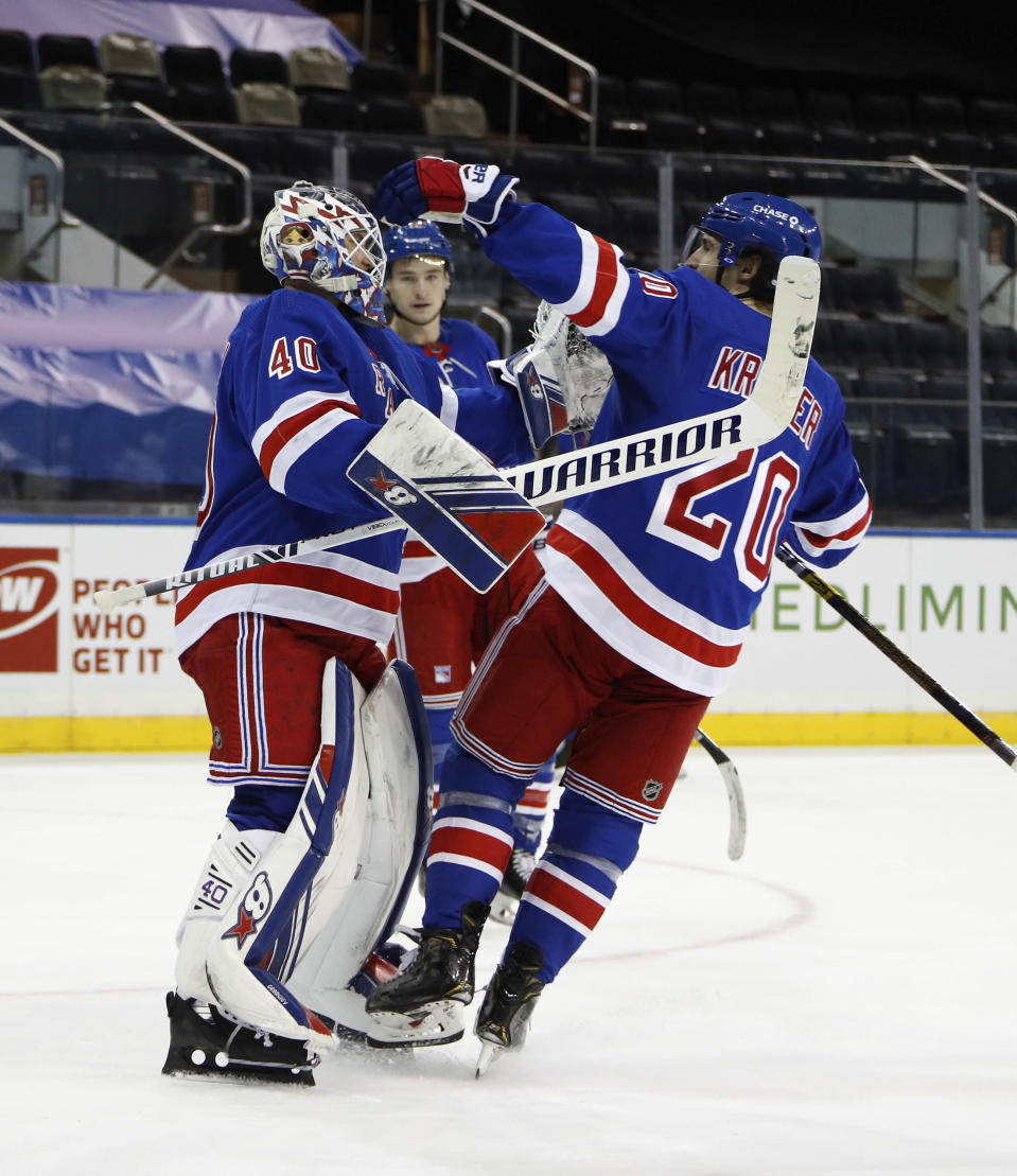 New York Rangers goalie Alexandar Georgiev, left, and teammates celebrate a win over the New York Islanders in an NHL hockey game Saturday, Jan. 16, 2021, in New York. (Bruce Bennett/Pool Photo via AP)
