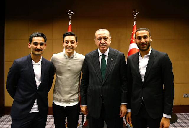 Turkish President Tayyip Erdogan meets with Premier League soccer players Ilkay Gundogan of Manchester City, Mesut Ozil of Arsenal and Cenk Tosun of Everton in London, Britain May 13, 2018. Picture taken May 13, 2018. Kayhan Ozer/Presidential Palace/Handout via REUTERS ATTENTION EDITORS - THIS PICTURE WAS PROVIDED BY A THIRD PARTY. NO RESALES. NO ARCHIVE.