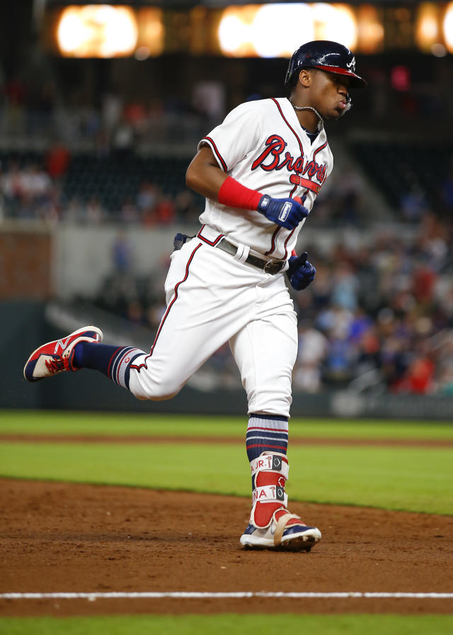 Atlanta Braves' Ronald Acuna Jr. rounds third after hitting a home run during the third inning of the team's baseball game against the St. Louis Cardinals, Tuesday, Sept. 18, 2018, in Atlanta. (AP Photo/Todd Kirkland)