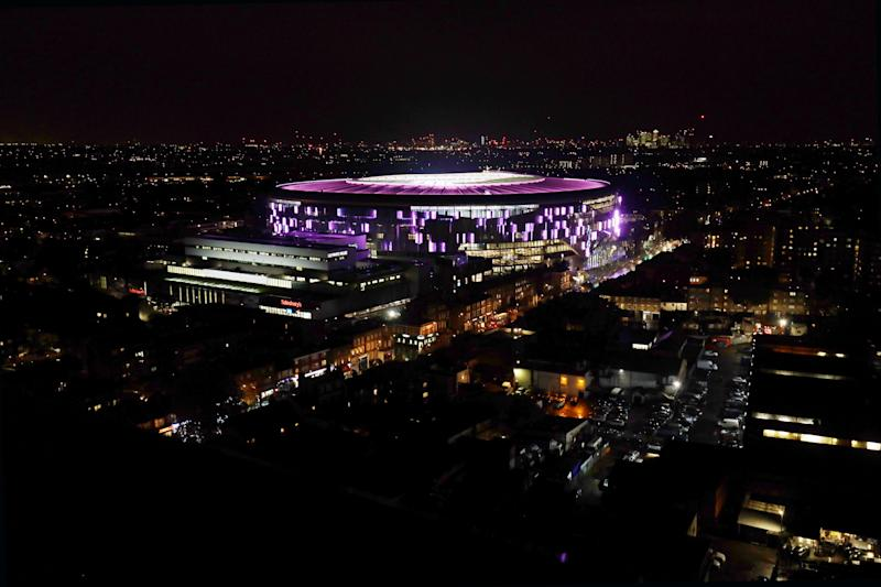 "ENFIELD, ENGLAND - OCTOBER 17: Tottenham Hotspur stadium is lit up pink to support Breast Cancer Now's, ""Wear it Pink"" day at Tottenham Hotspur Stadium on October 17, 2019 in Enfield, England. (Photo by Tottenham Hotspur FC/Tottenham Hotspur FC via Getty Images)"