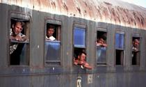 <p>Refugees from the camp in Kukes, Albania, wait on a train to leave the station in Shkoder, Albania for another camp in Durres in southern Albania, May 1999. The trains were decommissioned castoffs with windows edged with broken glass. Hundreds of thousands of Kosovo Albanians were driven from their homes into refugee camps in Macedonia and Albania in 1999 by the Serbian military. (Photo by Chris Hondros/Getty Images) </p>