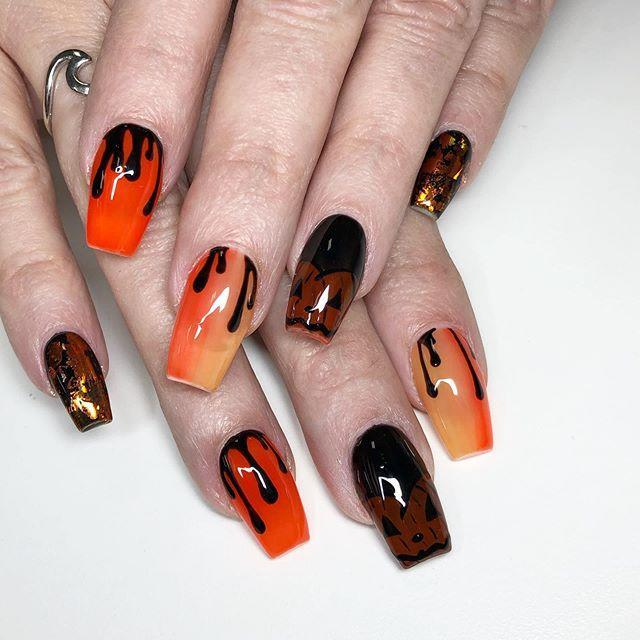"<p>Bring your love of jack-o'-lanterns to your nails with this gorg pumpkin-on-fire design. Plus, the dripping detail will make you look V edgy. </p><p><a href=""https://www.instagram.com/p/B3uUR7DgNwn/?utm_source=ig_embed&utm_campaign=loading"" rel=""nofollow noopener"" target=""_blank"" data-ylk=""slk:See the original post on Instagram"" class=""link rapid-noclick-resp"">See the original post on Instagram</a></p>"