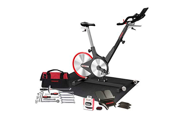 """<p><strong>Keiser</strong></p><p>amazon.com</p><p><strong>$1995.00</strong></p><p><a href=""""https://www.amazon.com/dp/B00LSX8AA0?tag=syn-yahoo-20&ascsubtag=%5Bartid%7C2089.g.35056250%5Bsrc%7Cyahoo-us"""" rel=""""nofollow noopener"""" target=""""_blank"""" data-ylk=""""slk:Shop Now"""" class=""""link rapid-noclick-resp"""">Shop Now</a></p><p>We'll be honest, the <a href=""""https://www.amazon.com/dp/B00LSX8AA0?tag=syn-yahoo-20&ascsubtag=%5Bartid%7C2089.g.35056250%5Bsrc%7Cyahoo-us"""" rel=""""nofollow noopener"""" target=""""_blank"""" data-ylk=""""slk:Keiser M3i"""" class=""""link rapid-noclick-resp"""">Keiser M3i</a> isn't much cheaper than a Peloton, but this bundle comes with a floor mat, media tray, stretch pads, a heart rate, and an M Series Converter that makes this bike compatible with any external app making it the premier option for the rider that wants a top of the line bike without being locked into one app. Another shining feature: Orange Theory Fitness fans may recognize the <a href=""""https://www.amazon.com/dp/B00LSX8AA0?tag=syn-yahoo-20&ascsubtag=%5Bartid%7C2089.g.35056250%5Bsrc%7Cyahoo-us"""" rel=""""nofollow noopener"""" target=""""_blank"""" data-ylk=""""slk:Keiser M3i"""" class=""""link rapid-noclick-resp"""">Keiser M3i</a> as the same bike the popular fitness franchise uses in-studio. It also touts that it's adjustable to a wide variety of heights so riders 4'10"""" to 7' can find the perfect fit for their ride. </p>"""