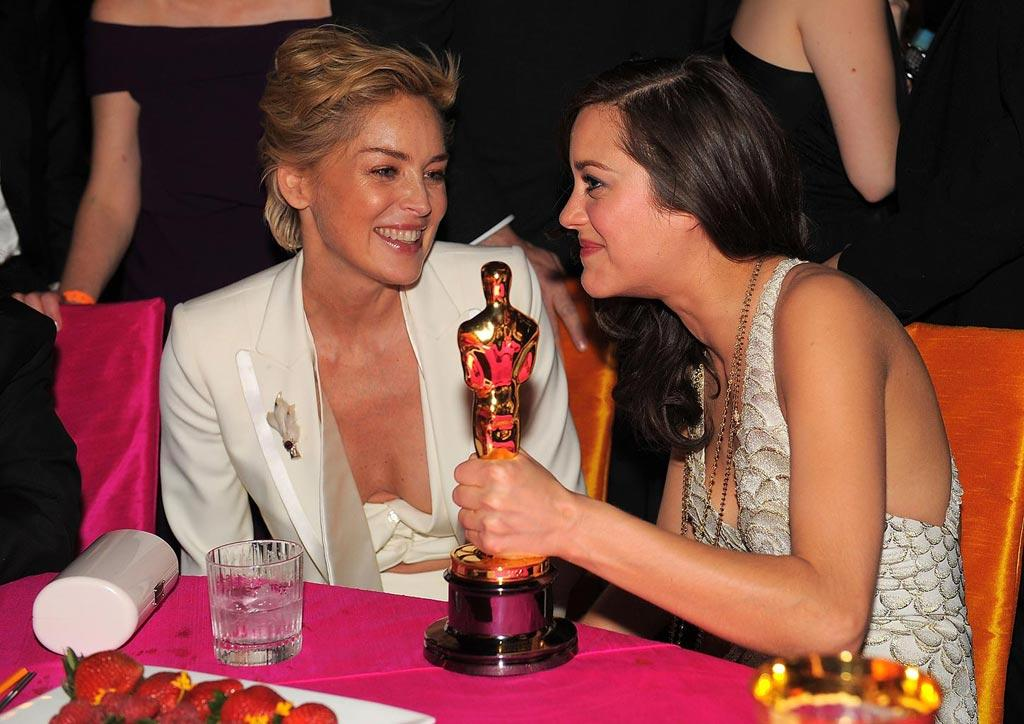 """<a href=""""http://movies.yahoo.com/movie/contributor/1800012231"""">Sharon Stone</a> and <a href=""""http://movies.yahoo.com/movie/contributor/1800277301"""">Marion Cotillard</a> attend the 16th Annual Elton John AIDS Foundation Oscar Party at the Pacific Design Center in West Hollywood - 02/24/2008"""