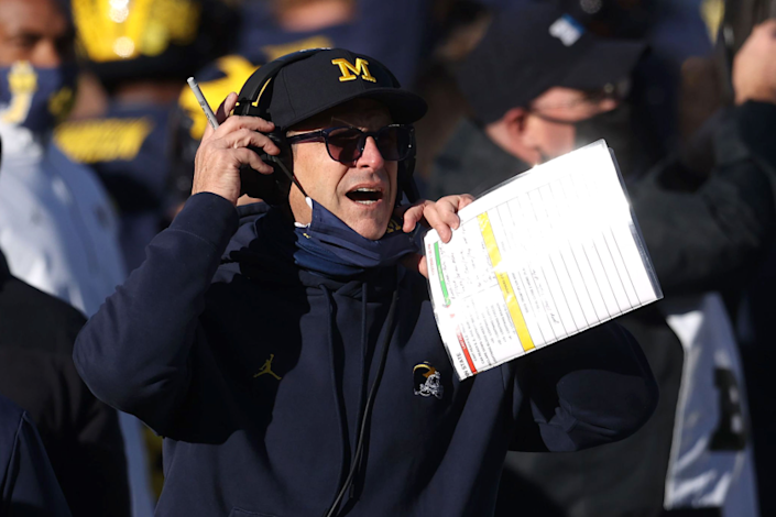 ANN ARBOR, MICHIGAN - NOVEMBER 28: Head coach Jim Harbaugh of the Michigan Wolverines reacts.