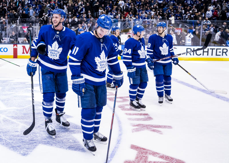 TORONTO, ON - FEBRUARY 29: Martin Marincin #52 of the Toronto Maple Leafs and Zach Hyman #11 celebrate after defeating the Vancouver Canucks at the Scotiabank Arena on February 29, 2020 in Toronto, Ontario, Canada. (Photo by Mark Blinch/NHLI via Getty Images)