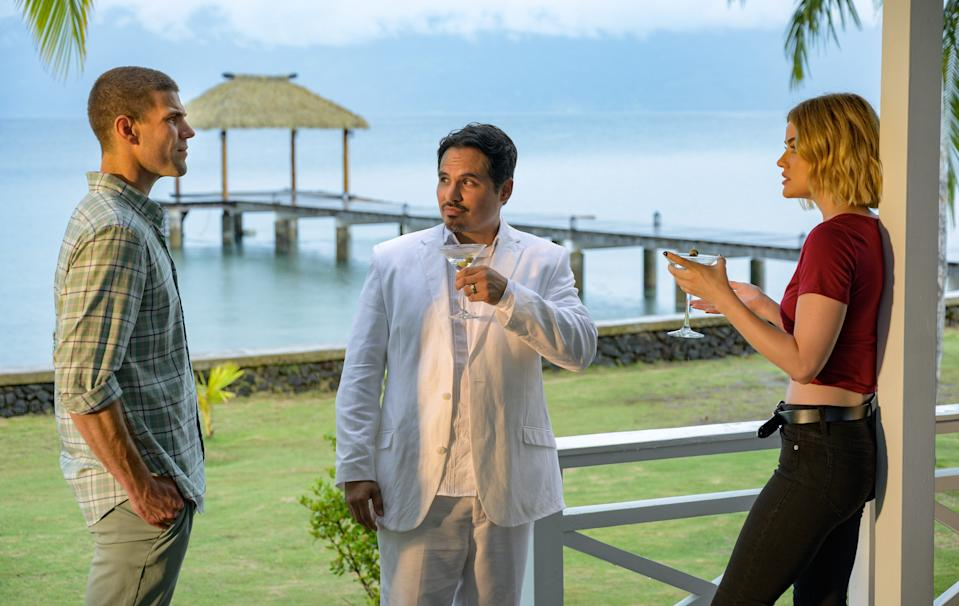 """The enigmatic Mr. Roarke (Michael Peña, center) welcomes guests (Austin Stowell and Lucy Hale) to a gorgeous locale where secret dreams become nightmares in """"Blumhouse's Fantasy Island,"""" horror guru Jason Blum's supernatural take on the old TV show."""