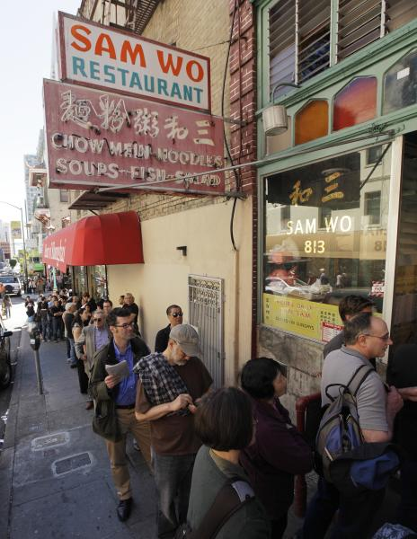 "Customers line up for one final meal at the Sam Wo restaurant in Chinatown in San Francisco, Friday, April 20, 2012. The 100-year-old Chinese restaurant known for having ""the world's rudest waiter"" is shutting its doors and serving its last customers Friday. (AP Photo/Eric Risberg)"