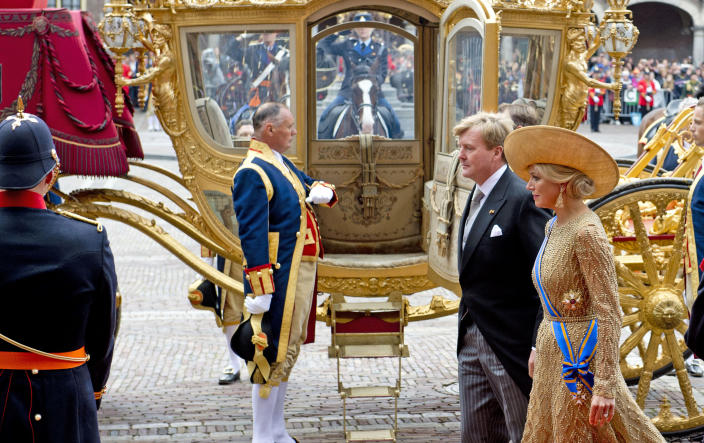 """Netherlands' King Willem-Alexander and his wife Queen Maxima arrive for the opening of the new parliamentary year with a speech outlining the government's plan and budget policies for the year ahead, at the 13th century """"Hall of Knights"""" in The Hague, Netherlands, Tuesday, Sept. 17, 2013. (AP Photo/Robin Utrecht, Pool)"""