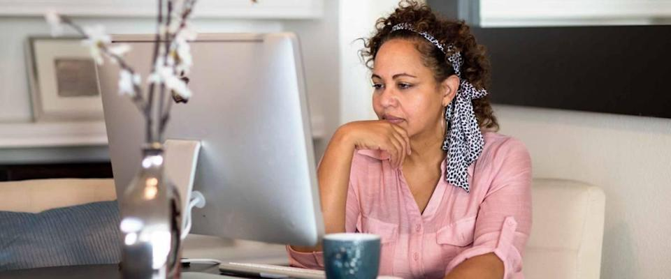 Woman concentrating and working from her home office.